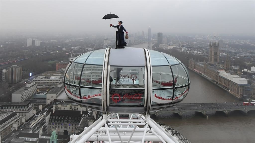 Let's go Eye a kite: In the film, Mary descends from the skies on a kite... and yesterday a stunt double rode on top of a capsule on the London Eye to mark last night's premiere in the capital PICTURE: PA