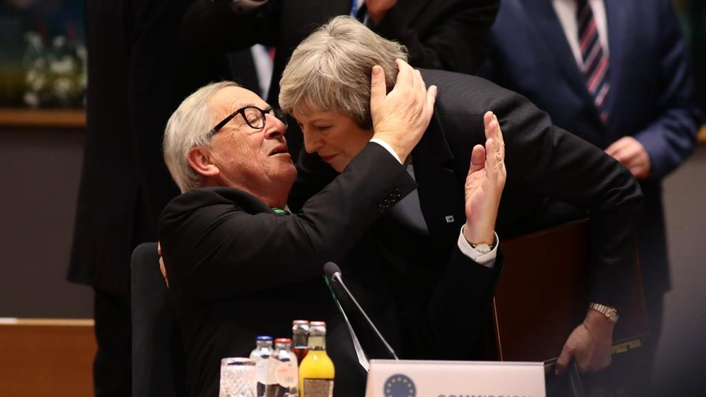 Friendly terms President of the European Commission Jean Claude Juncker greets Theresa May at the start of the two-day EU summit in Brussels