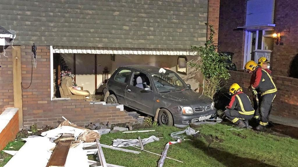 Unwelcome guest: The house in Dudley, West Midlands, where a car ended up in its front room PIC: PA