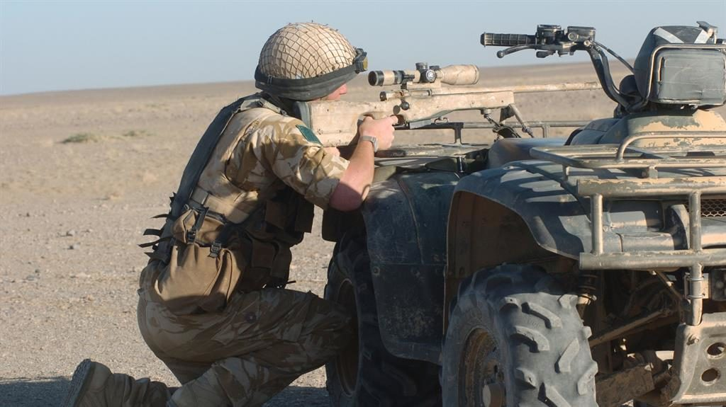 Attack: British soldier in desert PICTURE: ALAMY
