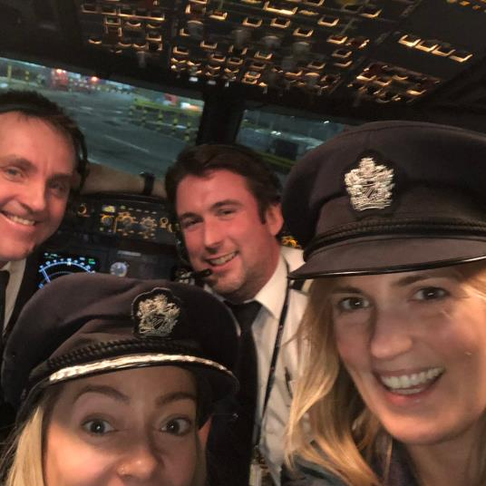 Feeling perky: Reporter Sarah Rogers (right) on the flight deck of a BA plane