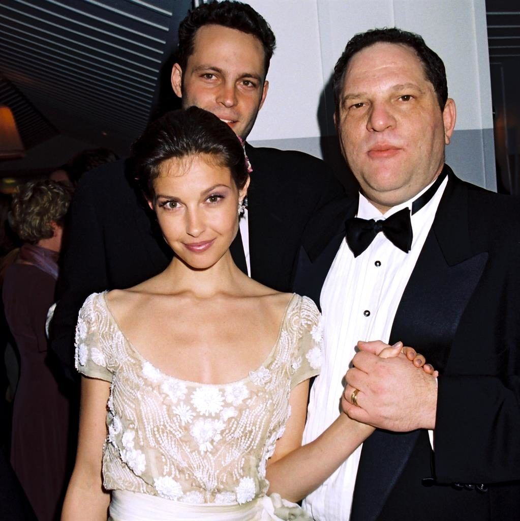 'Damaged her reputation': Harvey Weinstein with Ashley Judd and Vince Vaughn at a 1997 Oscars party PICTURE: REX/GETTY