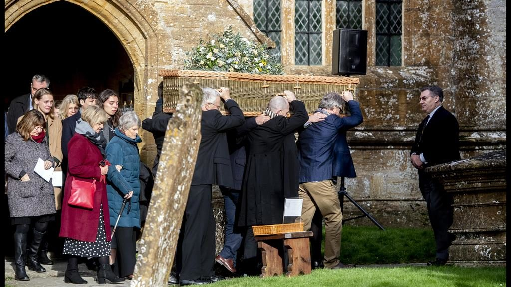 Farewell: Lord Ashdown's widow Jane, in blue coat, follows the wicker coffin from the small village church where the service was held PICTURE: I-IMAGES