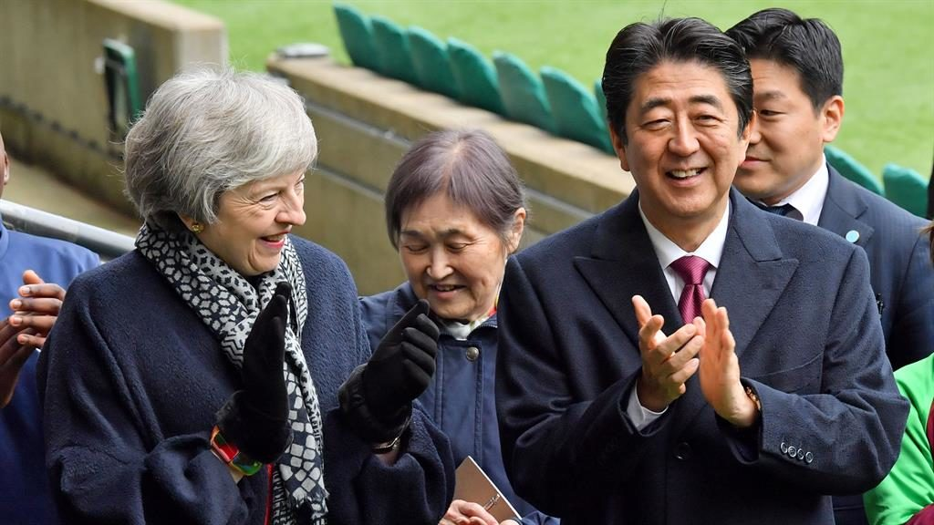 Support: Shinzo Abe and Theresa May on their visit to Twickenham PICTURE: REX