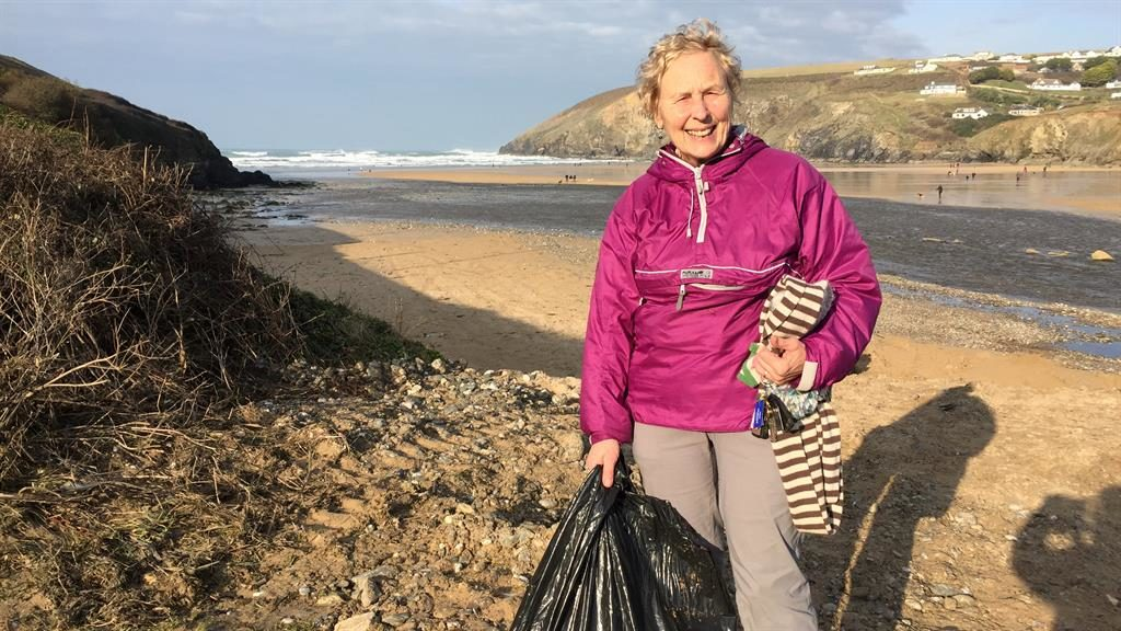 Tide-y up: Pat Smith keeping her resolution to clean a beach in Devon and Cornwall every week for a year PICTURE: SWNS