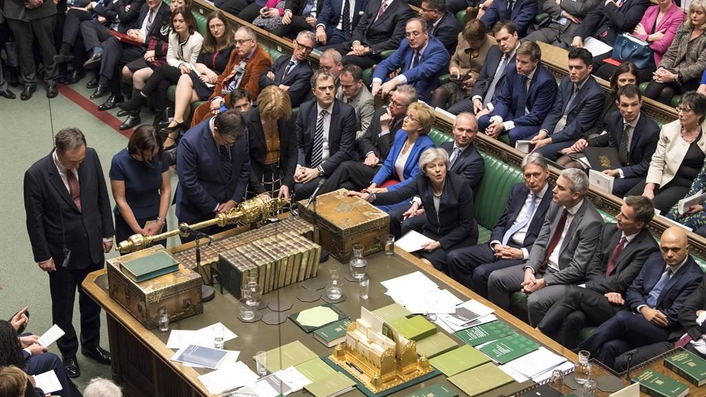 Moment of truth: The prime minister clutches the despatch box as she waits for the result of the Commons vote PICTURES: MARK DUFFY/AP/PA/GETTY