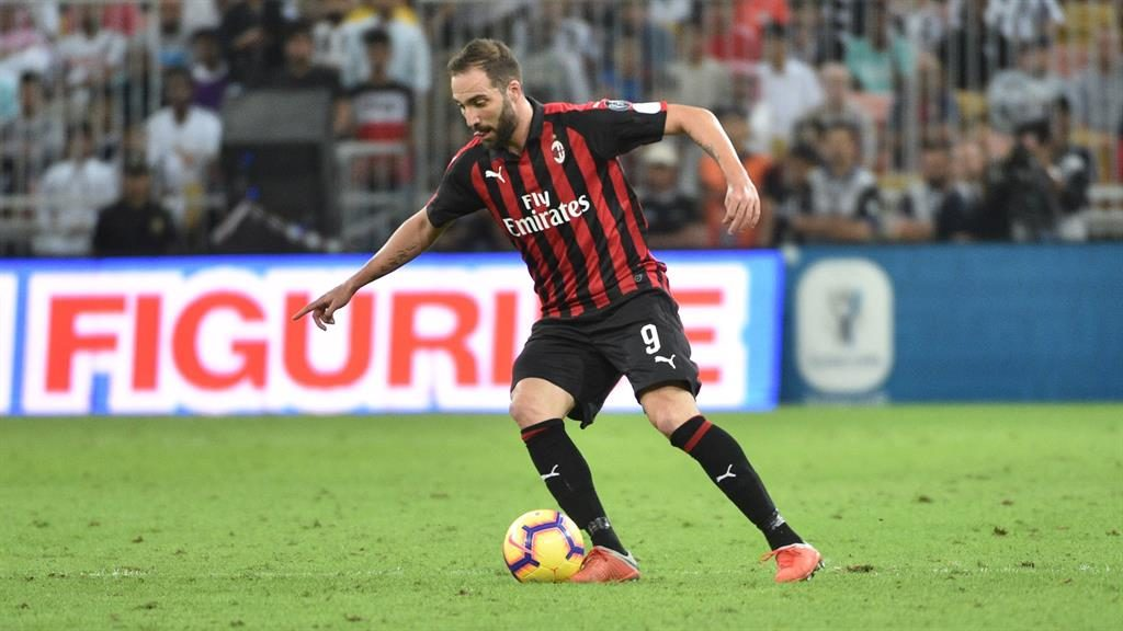 Reunited: Higuain looks set to team up again with former boss Sarri (below with the striker)