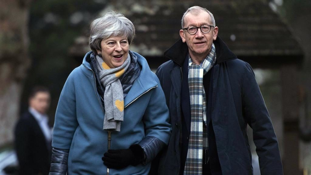 Appeal to rebels: Theresa May arrives at church yesterday with husband Philip PIC: EPA