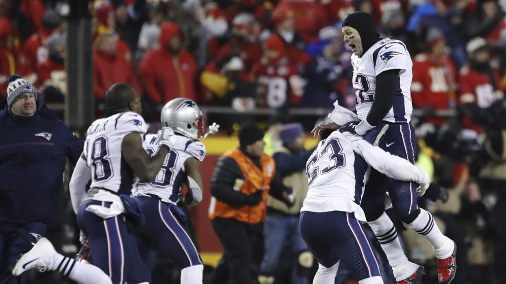 Major Tom: Brady (right) celebrates after reaching his ninth Super Bowl PICTURE: AP