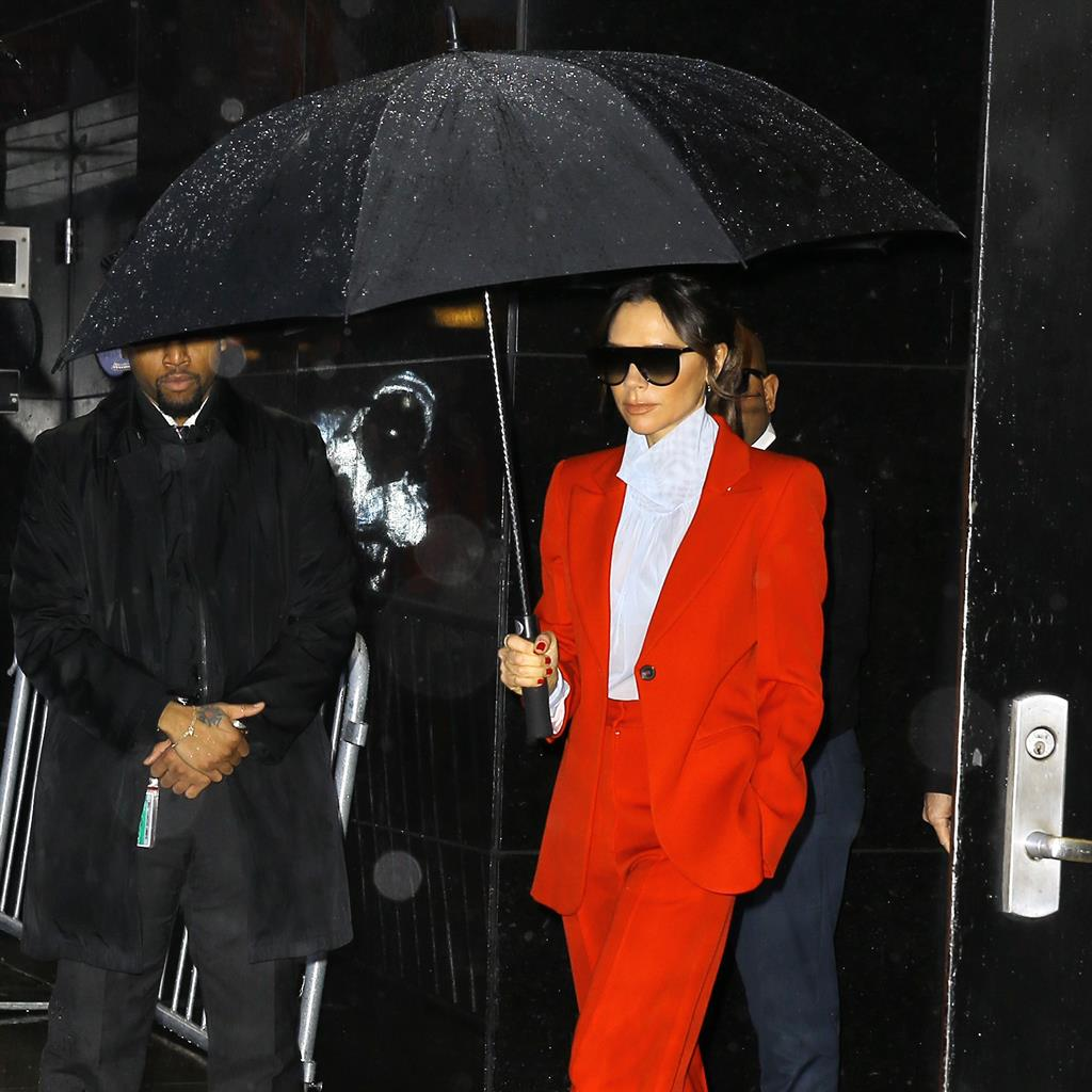 Victoria Beckham goes all Prince in red trouser suit			 				     by Andrei Harmsworth    Published
