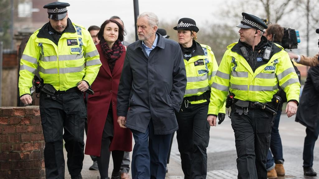 Under fire: Jeremy Corbyn meets police on a visit to Milton Keynes yesterday