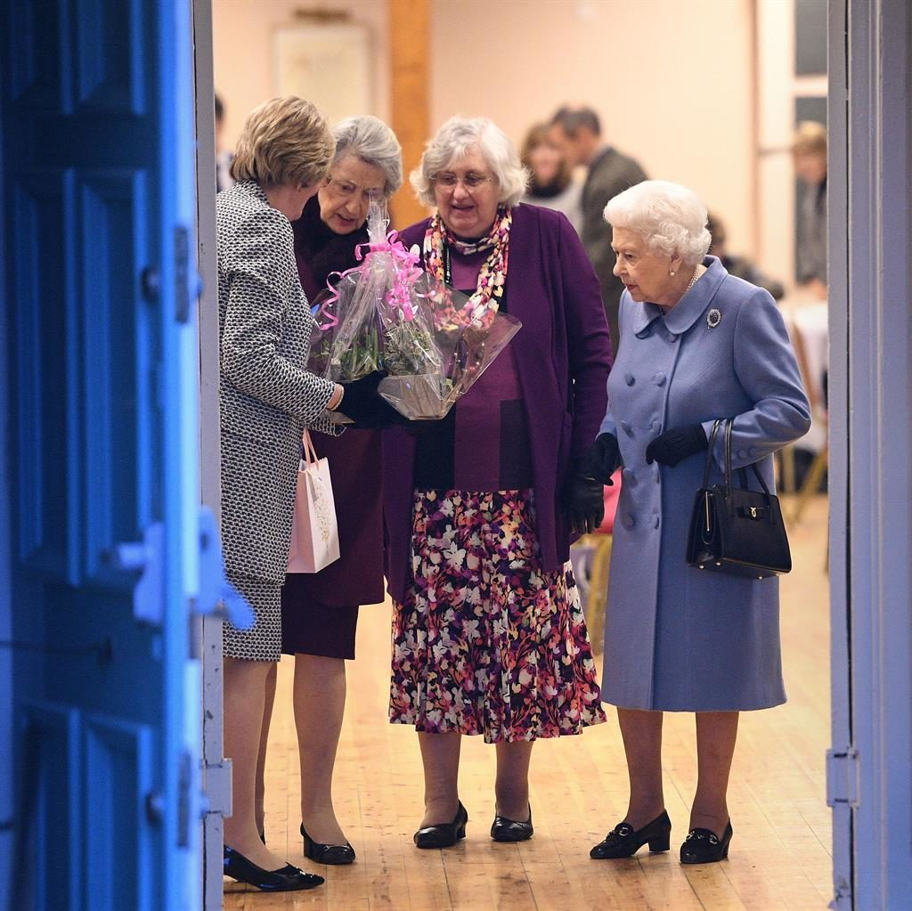 One's won: The Queen leaving the village hall yesterday with Armstrong, (below) in the background PICTURES: JOE GIDDENS/PA/ALBAN