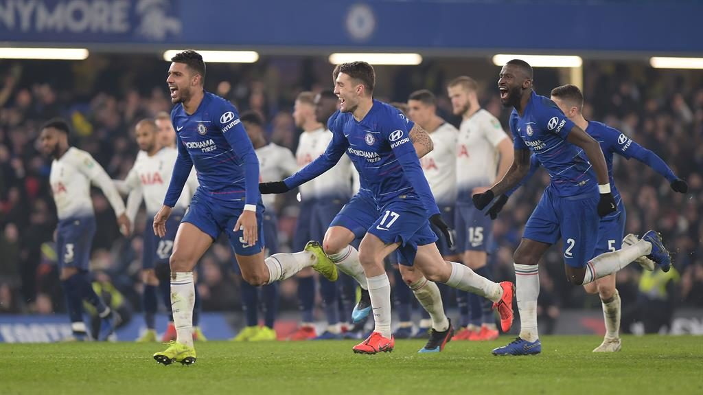 Contrasting emotions: Chelsea players race to celebrate the winning penalty as Spurs' dejected players look on while Chelsea new-boy Gonzalo Higuain (below) was introduced to the crowd