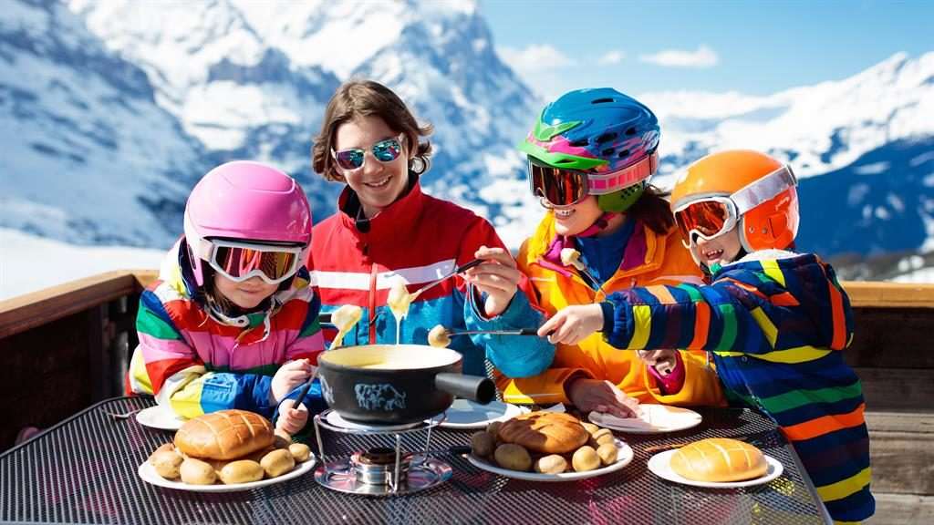 Get stuck in: There's more to a skiing holiday than the slopes — like the lip-smacking gooeyness of a traditional fondue
