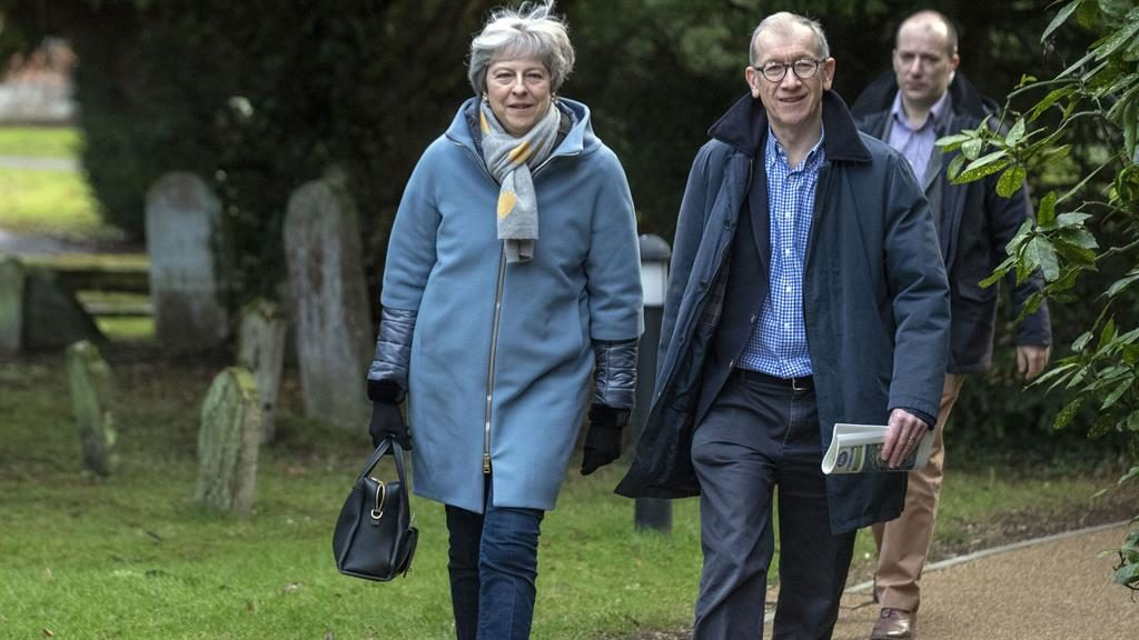 Next step: Theresa May and husband Philip leaving church in her Maidenhead constituency yesterday PICTURE: PA