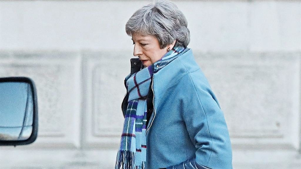 Get in step: Theresa May urged Tory MPs to back her plan to replace the backstop with 'alternative arrangements' PICTURE: PA