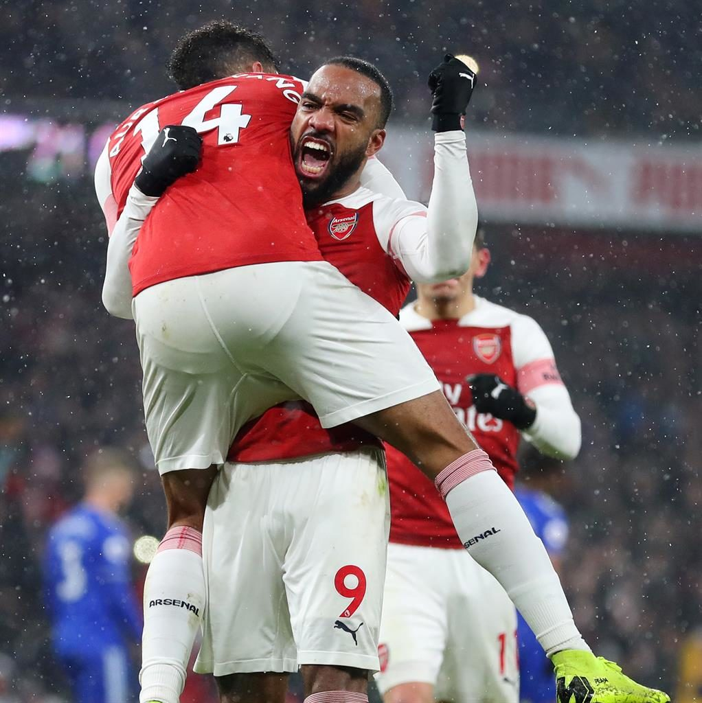 Smash and carry: Aubameyang gets a lift from fellow goalscorer Lacazette PICTURE: GETTY