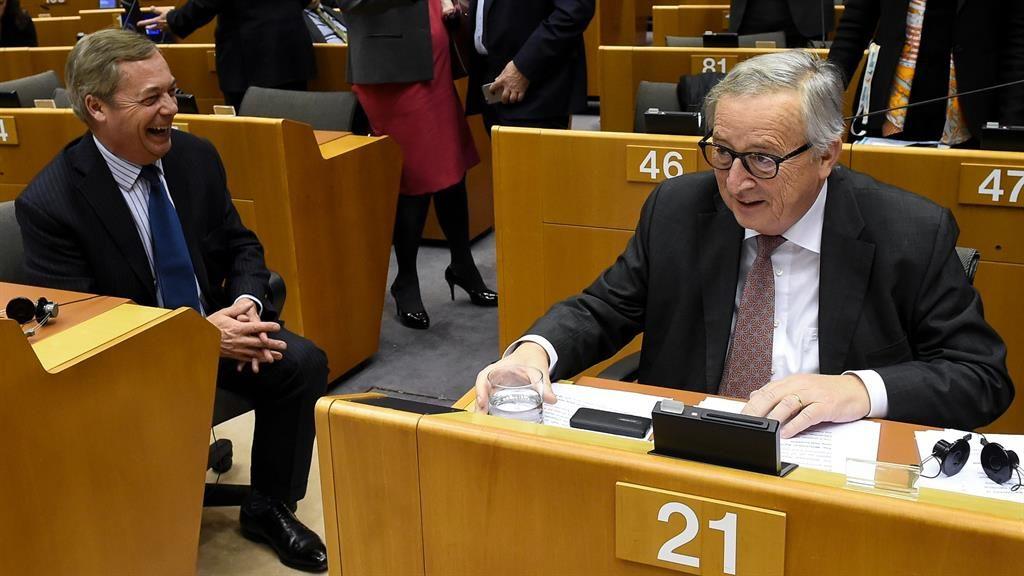 EU said it: Jean-Claude Juncker (right) and Nigel Farage share a joke PICTURE: GETTY