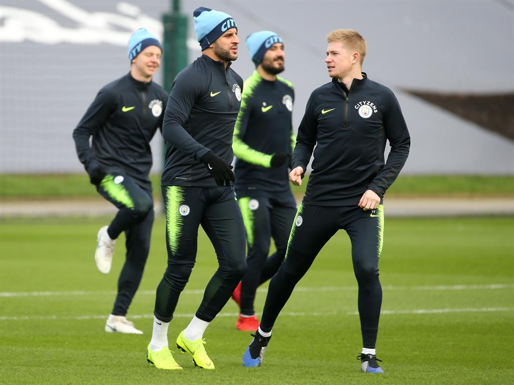Muscling in De Bruyne trains with his City team-mates yesterday