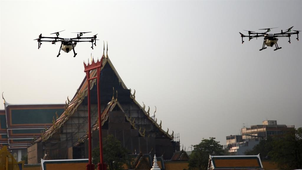 Air aid: Drones spray water over Wat Suthat temple in Bangkok yesterday PICTURE: AP
