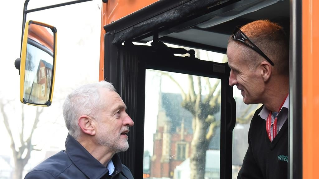 Bussy day: Jeremy Corbyn chats to a Nottingham driver before his trip to Ilkeston yesterday PICTURE: PA