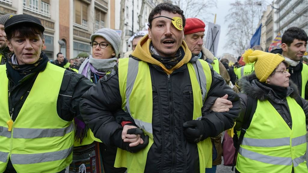 In the firing line: A yellow vest protester in Paris dons an eye patch PICTURE: REX
