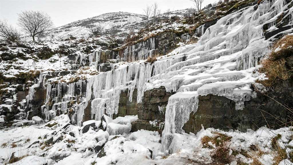 Brrrr: A frozen waterfall in the Brecon Beacons National Park, Wales PICTURE: PA