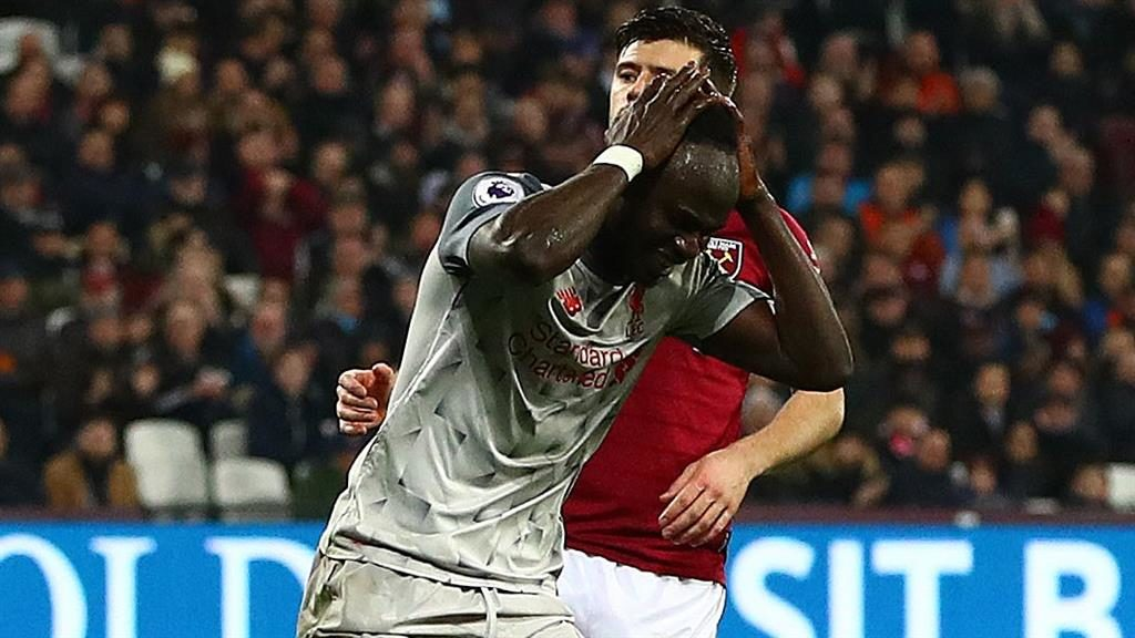 Missed opportunity: Mane holds his head in his hands PICTURE: REX
