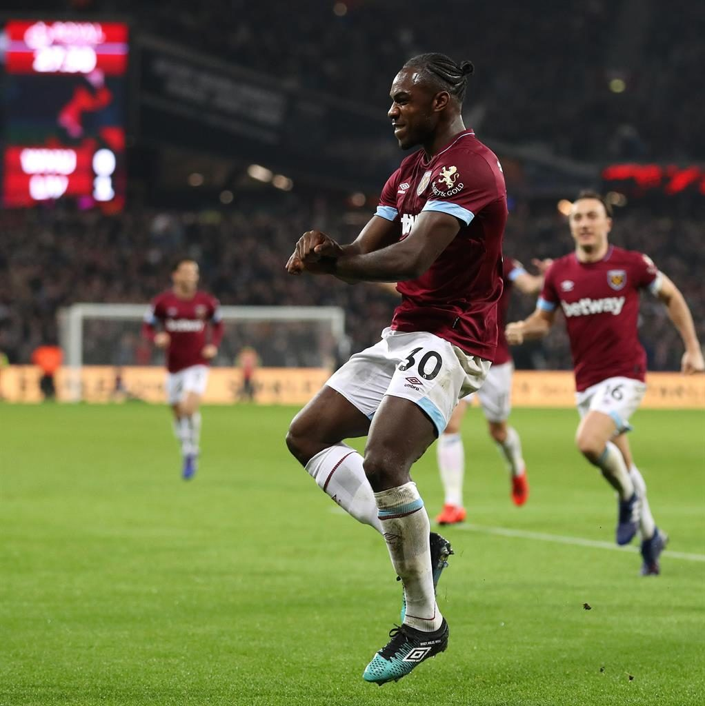 Ant music: Hammers scorer Antonio dances to celebrate his goal on a tough night for Reds boss Klopp (below) PICTURES: GETTY/REX