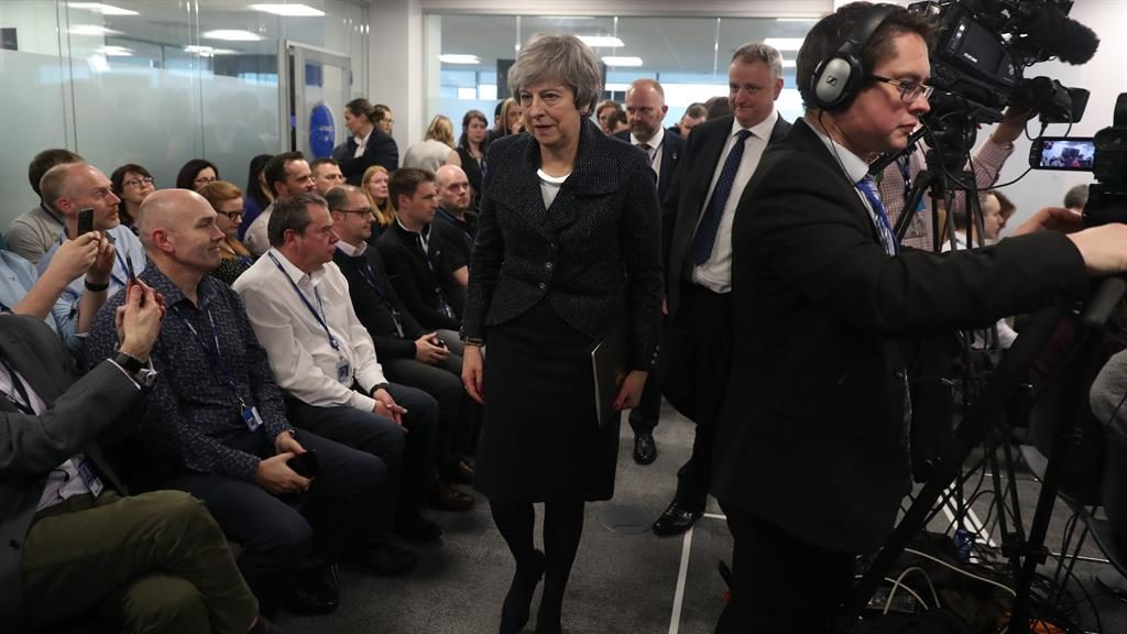 Stating her case: Theresa May with business figures in Belfast yesterday PICTURE: PA
