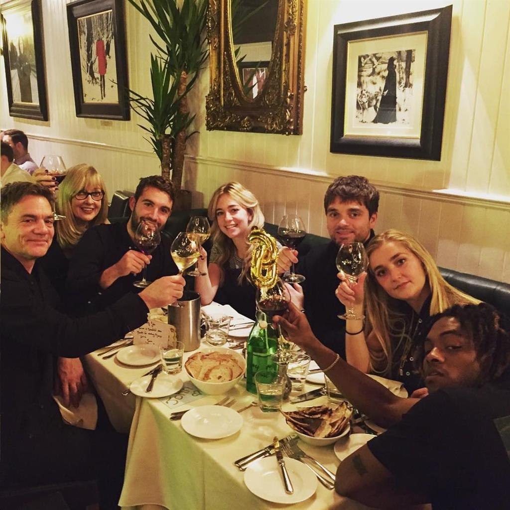 Family meal: (From left) John Michie, wife Carol, son Sam and (from right) Broughton and Louella