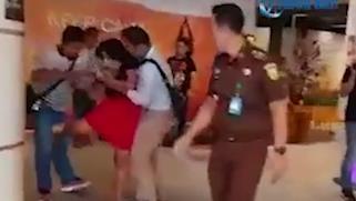 Kicking and screaming: Taqaddas lashed out during her arrest yesterday PICTURE: YOUTUBE