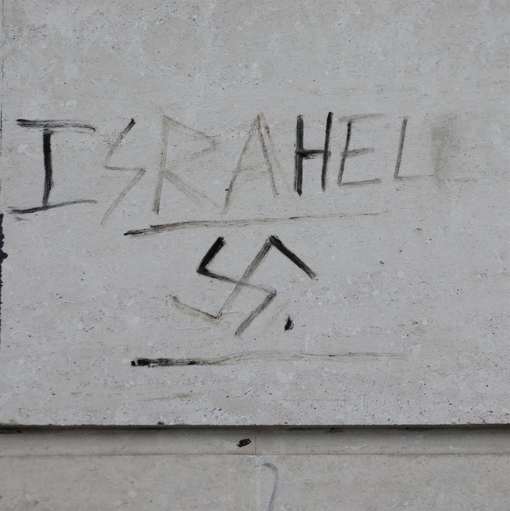 'No place in our society': Graffiti showing a swastika and the word 'Israhell' daubed on a wall in London PICTURE: PA