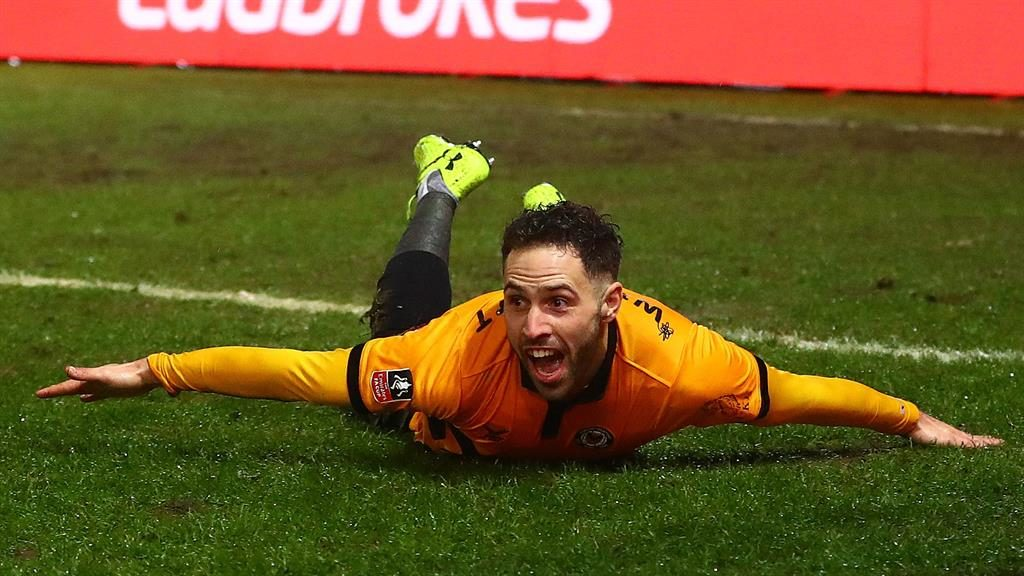 Soaking up the adulation: Willmott after scoring for Newport against Middlesbrough PICTURES: REX