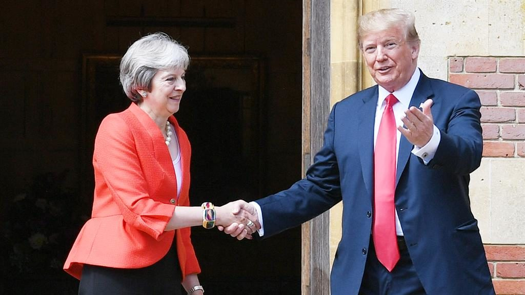 Security fears: Theresa May greets Donald Trump at Chequers last July during his first visit to UK PICTURE: GETTY