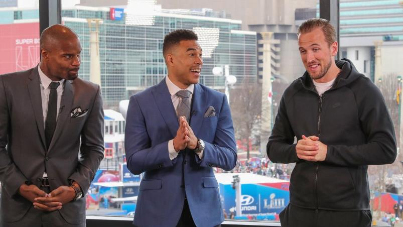 Forward thinking: Kane (right) with BBC pundits Umenyiora (left) and Bell at the Super Bowl