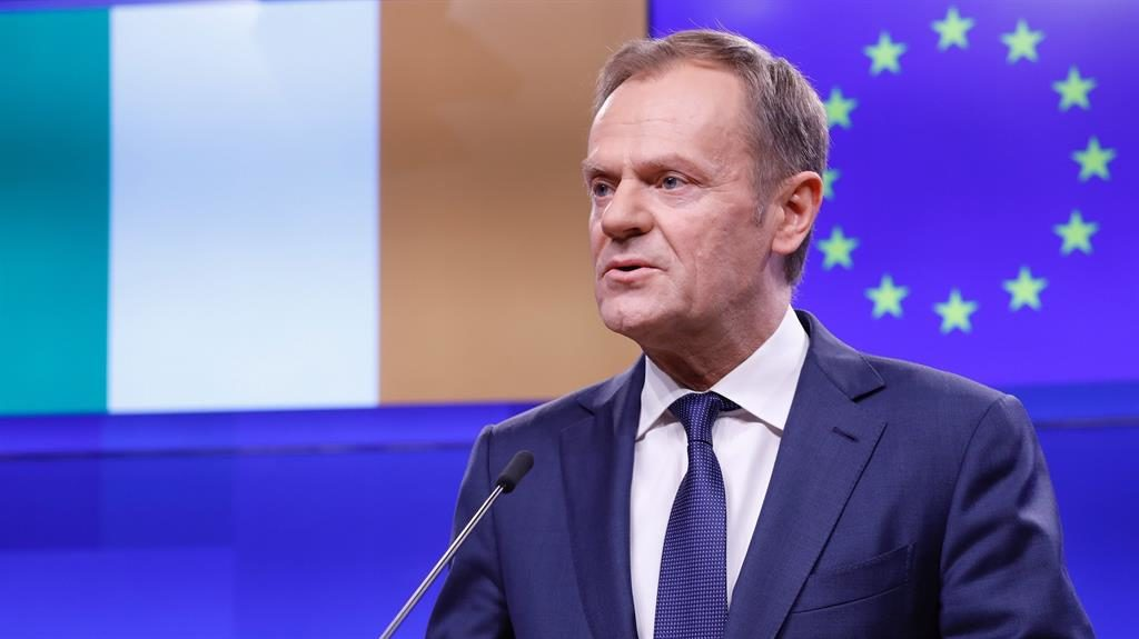 Taken to Tusk: The European Council president in Brussels and (below) Nigel Farage's retort PICTURE: GETTY