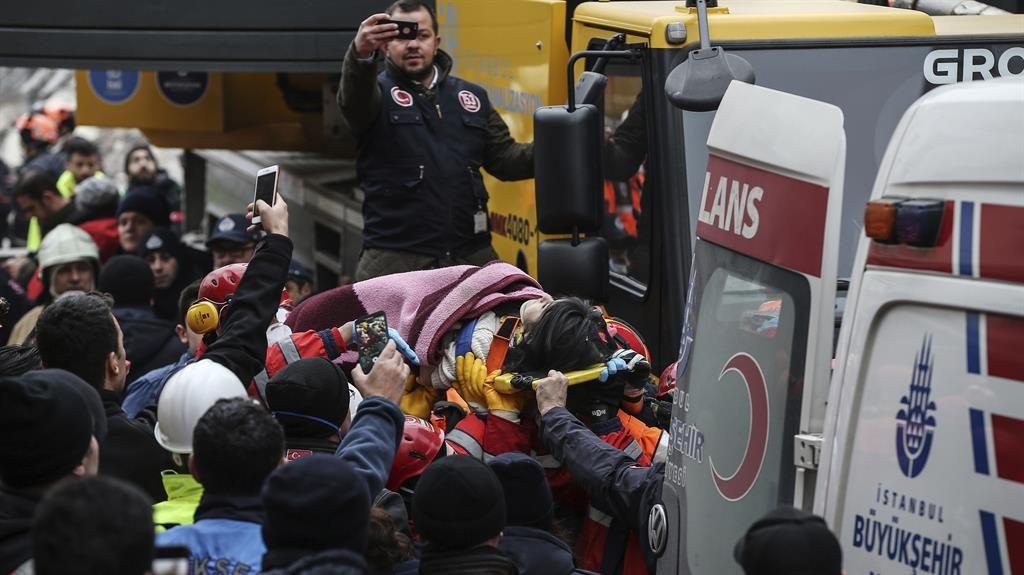 Survivor: Crowds gather to watch Havva taken to an ambulance PICTURE: AP