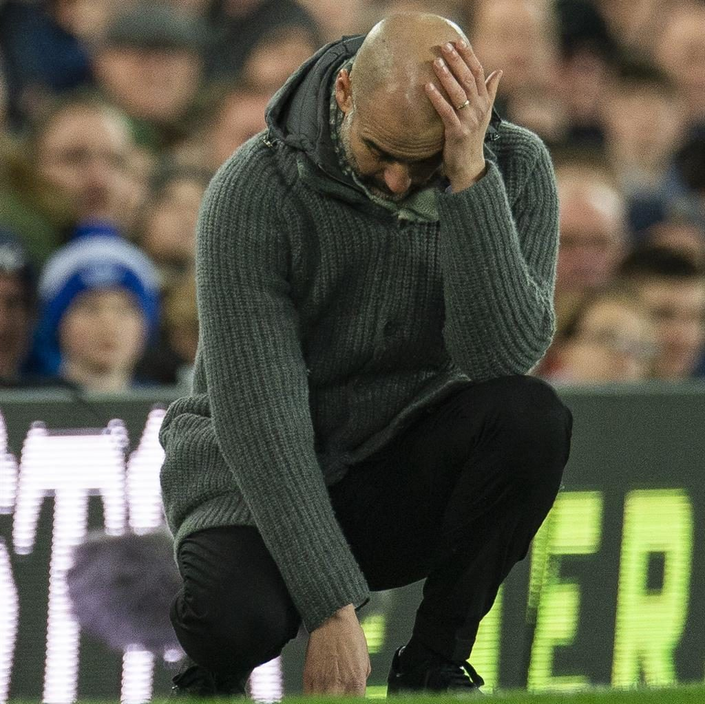 Title tussle: Guardiola feels the pressure at Everton in midweek PICTURE: EPA