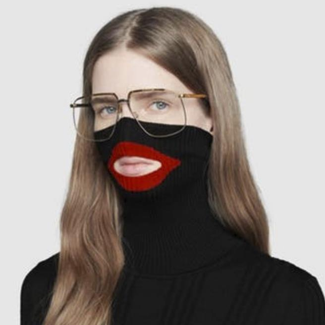 Lip slip: A model wears the 'racist' jumper and (below) Prada's controversial keyring PICTURES: AP