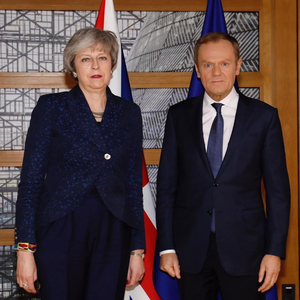 Frost in May: Unsmiling PM with Mr Tusk and (below) his tweet PICTURE: GETTY