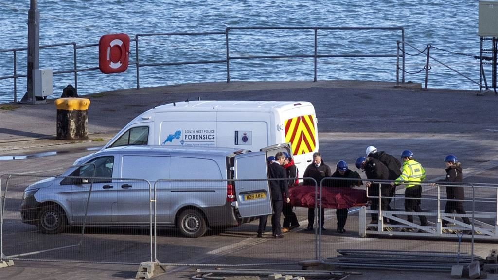 'Dignified': The body is moved off the quay in Portland, Dorset PICTURE: PA