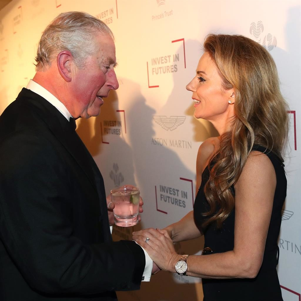 Reunited: Geri clasping the prince's hand last night PICTURE: GETTY