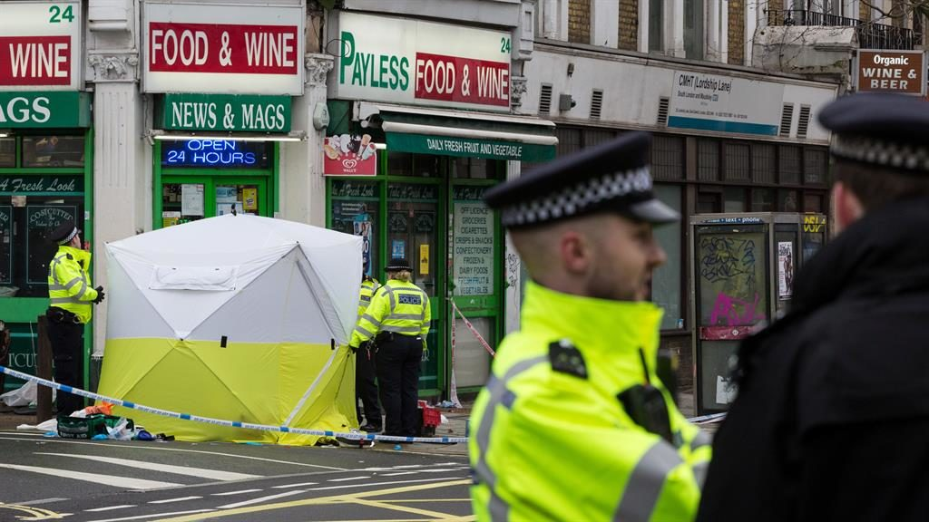 Murder: Police at scene of attack PICTURE: SWNS