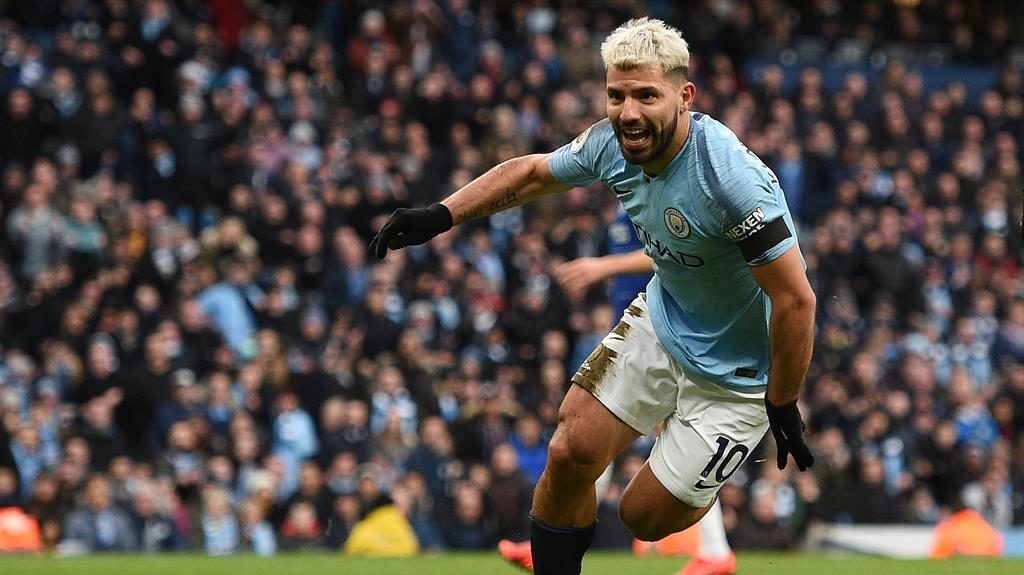 Hat-trick hero: Aguero celebrates after scoring his second against the battered Blues PICTURE: GETTY