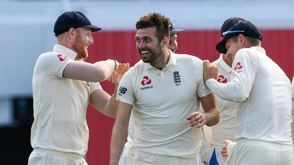 Beamer: Wood (centre) celebrates on his way to an excellent five-wicket haul PICTURE: GETTY