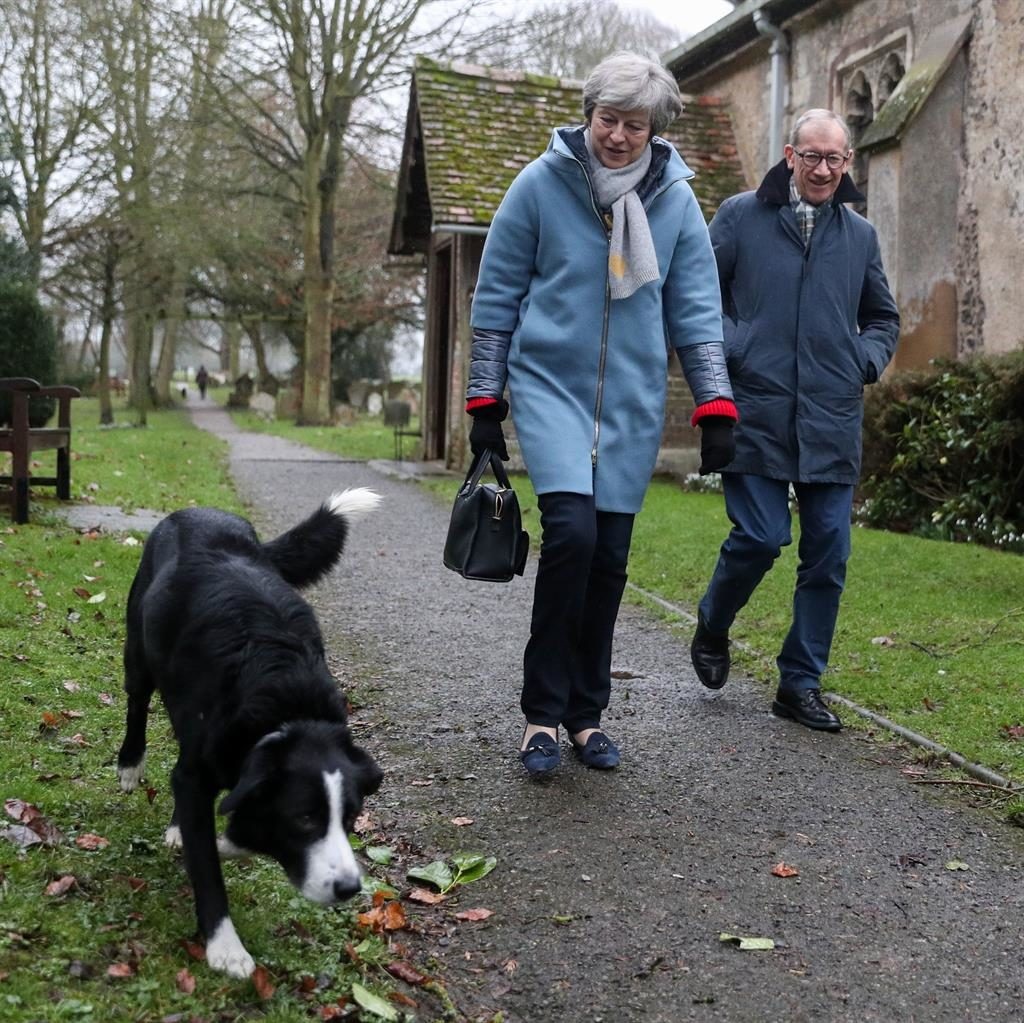 Pedigree chum: PM and husband Philip with Blitz, who they often see at church near her Maidenhead constituency PICTURE: PA