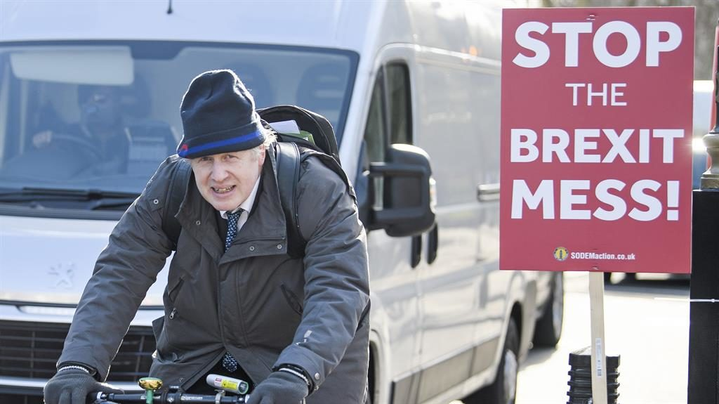 No messing: Boris Johnson on his bike yesterday after he warned against a deal with Labour PICTURE: LNP