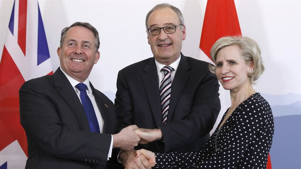 In the bag: Dr Fox with Mr Parmelin and Ms Frick PICTURE: AP
