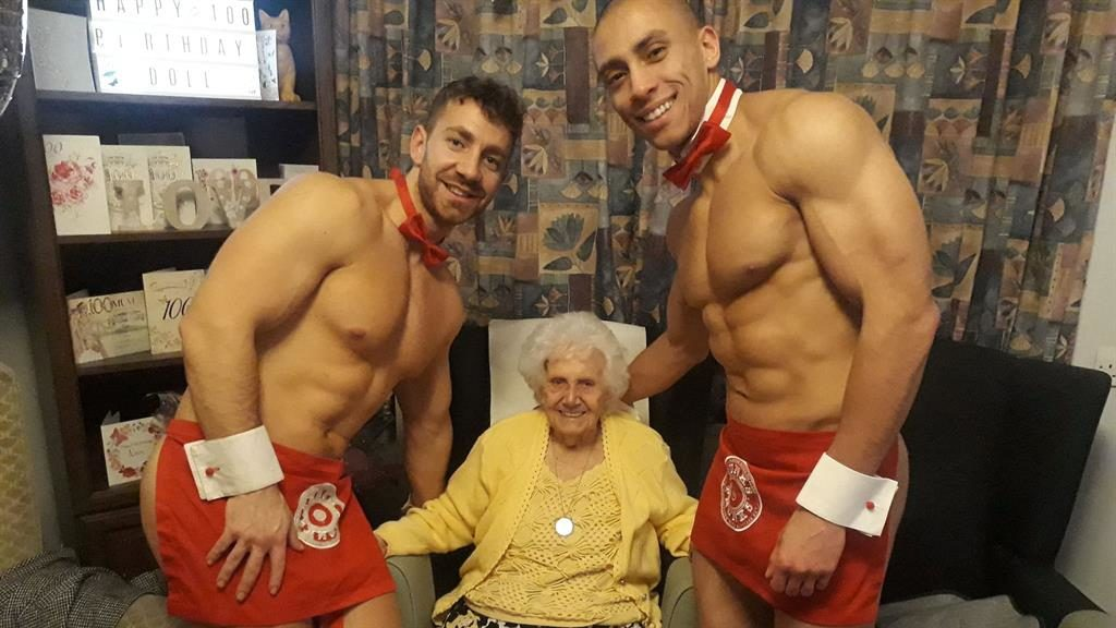 Feels good: Doll Jenkins celebrates her 100th birthday in style with half-naked hunks at Milton Lodge in Colchester, Essex PICTURES: SWNS